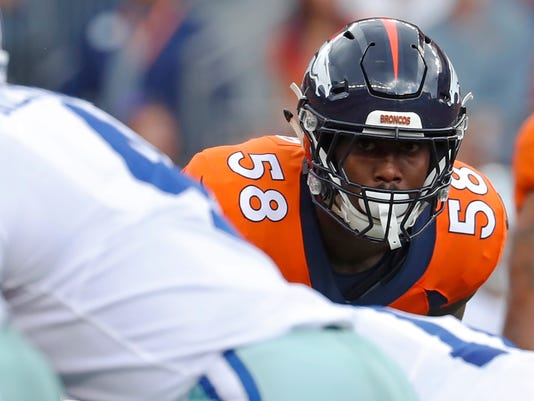 FILE - In this Sunday, Sept. 17, 2017 file photo, Denver Broncos outside linebacker Von Miller eyes Dallas Cowboys quarterback Dak Prescott during the first half of an NFL football game in Denver. The Broncos are allowing a league-low 50 yards rushing through the first month of the season, helping them hit their bye week at 3-1, a game behind the lone unbeaten Kansas City Chiefs in the AFC West. (AP Photo/Jack Dempsey, File)