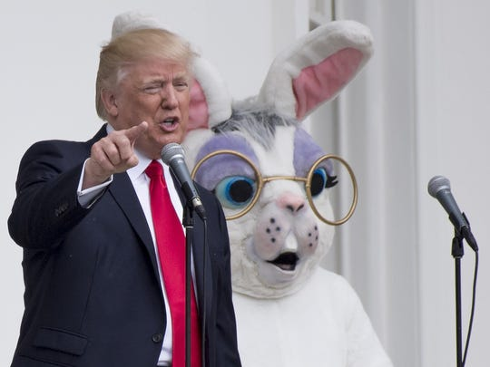 President Donald Trump speaks alongside the Easter Bunny during the 139th White House Easter Egg Roll on the South Lawn of the White House in Washington, D.C., April 17, 2017.