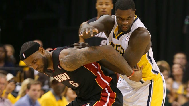 Indiana PacersÕ Lance Stephenson (1) and Miami Heat's LeBron James (6)  battle for a loose ball during the second half of action. The Indiana Pacers hosted the Miami Heat in Game 5 of the NBA Eastern Conference Finals Wednesday, May 28, 2014, at Bankers Life Fieldhouse in Indianapolis.