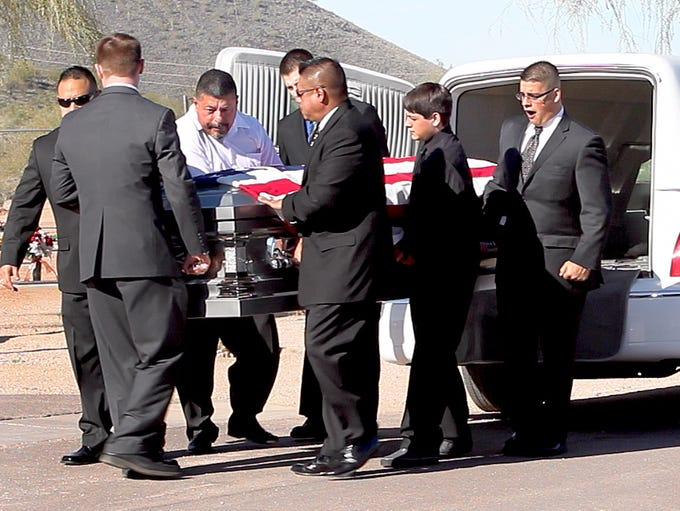 "Friends and family of Ernest ""Marty"" Atencio attend"