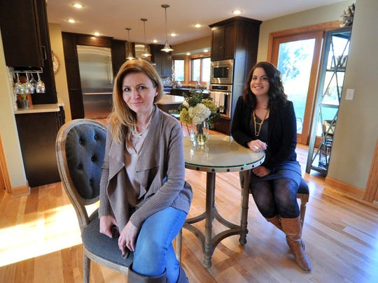 Designer Lecia Marks Franson, left, and her assistant Caitlin Eisch, pose for a photo Thursday at a customer's house in Wausau.