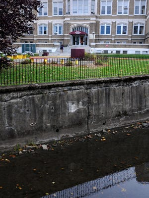 This file photo shows the Family Partnership Center and a section of the Fallkill Creek on North Hamilton Street in the City of Poughkeepsie.