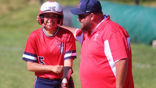 St. Henry senior Faith Kosco is all smiles at first base during St. Henry's 8-7 win over Dixie Heights in the 34th District softball championship game May 25, 2018 at Dixie Heights High School, Edgewood KY.