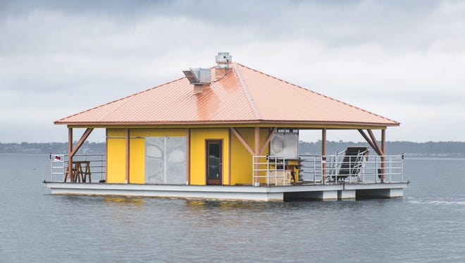 A mysterious floating restaurant that has appeared anchored at Navarre Beach has residents baffled.