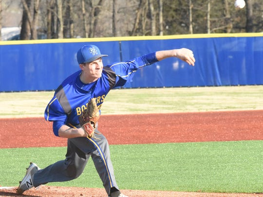 Mountain Home's Marshall Roberson throws a pitch during