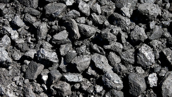 Pieces of coal sit on the ground at the Savage Energy Terminal on August 26, 2016 in Price, Utah.