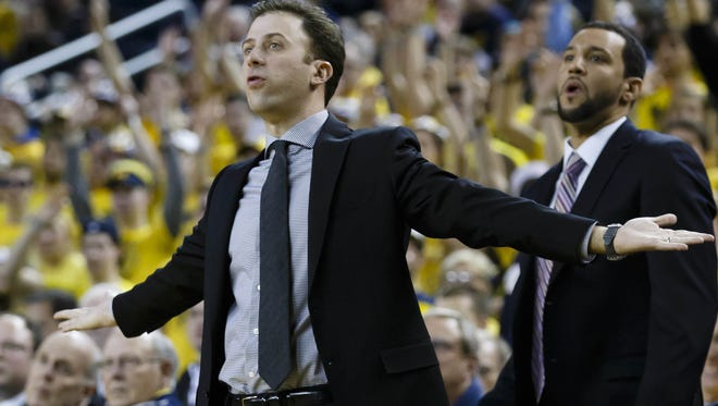 Minnesota basketball coach Richard Pitino reacts during a game against Michigan this season.
