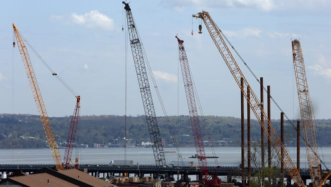 Construction barges work in the Hudson River near the Tappan Zee Bridge on May 1.