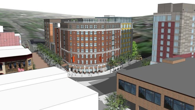 A new design of the State Street Triangle building proposed for 301 East State St. Under the new design, the spill lane, which would previously have been annexed as a pedestrian walkway, has been retained and the building's height has been reduced.