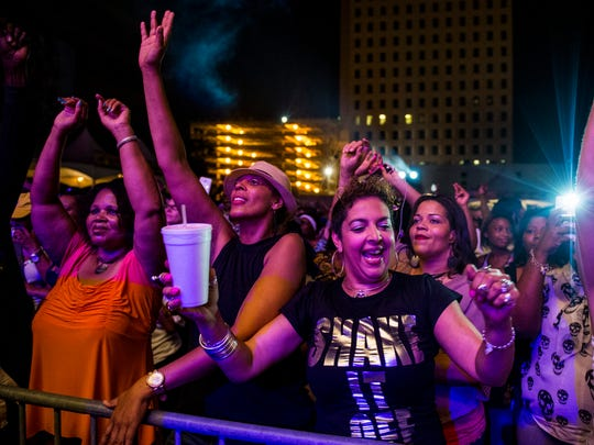 Spectators dance along to music from Lil' Nathan and