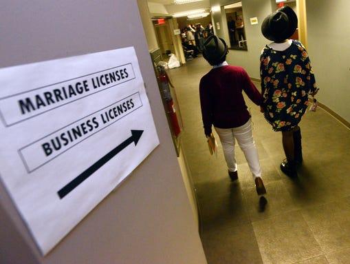 Same-sex couple Shante Wolfe and Tori Sisson prepare