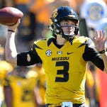 Missouri Tigers quarterback Drew Lock completed 21 of 28 passes for 136 yards and two touchdowns, helping the Tigers (4-1, 1-1) win their first conference game of the season.