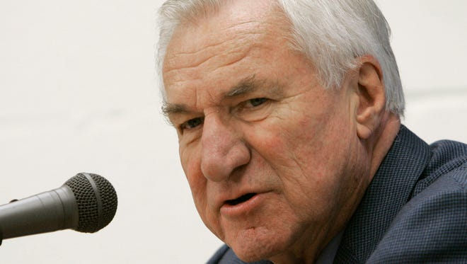 """In this Dec. 8, 2006 file photo, former North Carolina basketball coach Dean Smith answers questions during a press conference in Chapel Hill, N.C. Smith, the North Carolina basketball coaching great who won two national championships, died """"peacefully"""" at his home Saturday night."""