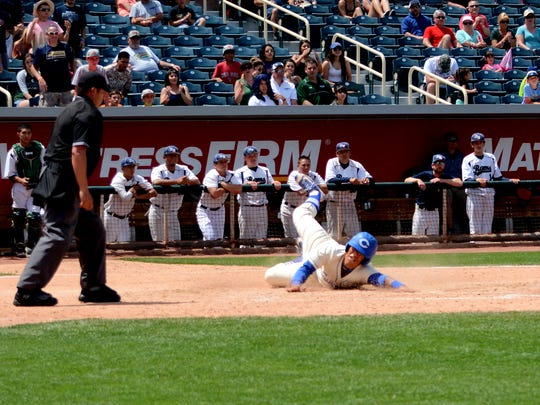 Carlsbad's Seth Olguin scores the game-winning run in the top of the ninth inning Saturday against Rio Rancho.