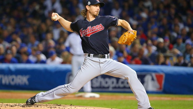 Cleveland Indians starting pitcher Josh Tomlin delivers a pitch during the first inning in Game 3 of the World Series against the Chicago Cubs at Wrigley Field.