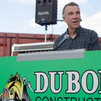 Phil Scott shows off a DuBois toy bulldozer given out to guests at the 70th anniversary party for DuBois Construction while Jeff Newton looks on