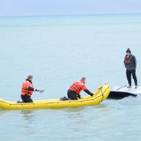 Teen rescued after car goes into Lake St. Clair