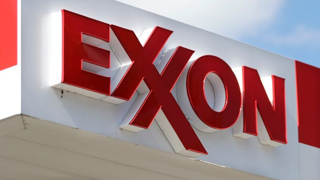 This 2017 file photo shows an Exxon service station sign in Nashville, Tenn.