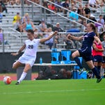 Redshirt senior midfielder Megan Fish kicks a ball during UCF's 3-2 loss to UConn on Sept. 27 .