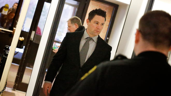 Thomas Clayton passes through a metal detector inside the Steuben County Office Building on Thursday. Clayton, who is accused of hiring Michael Beard to kill his wife, Kelley, in 2015, is charged with several murder counts.