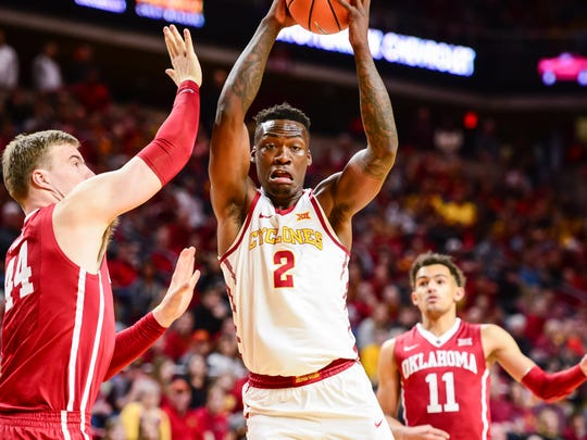 Iowa State Cyclones forward Cameron Lard (2) controls the ball as Oklahoma Sooners center Hannes Polla (44) defends and guard Trae Young (11) looks on during the second half at James H. Hilton Coliseum.