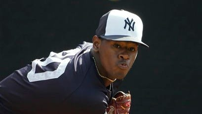 New York Yankees starting pitcher Luis Severino throws in the bullpen before a spring training baseball game against the Boston Red Sox Saturday, March 5, 2016, in Tampa, Fla.