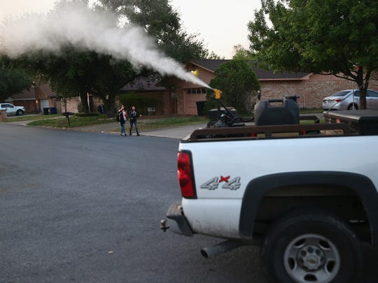 A neighborhood is sprayed for mosquitoes in April in