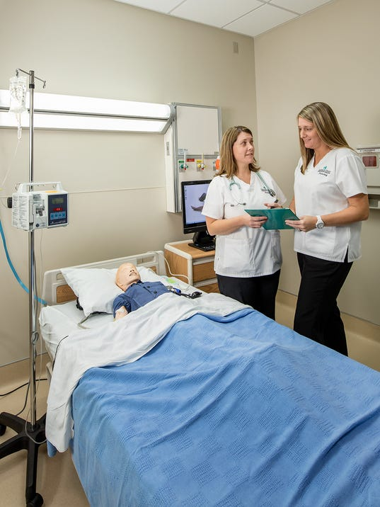 636453218871065824-Two-students-discuss-a-pediatric-patient-s-chart-in-one-of-the-simulation-suites.jpg