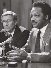 Gov. Evan Mecham (left) sits with civil-rights activist