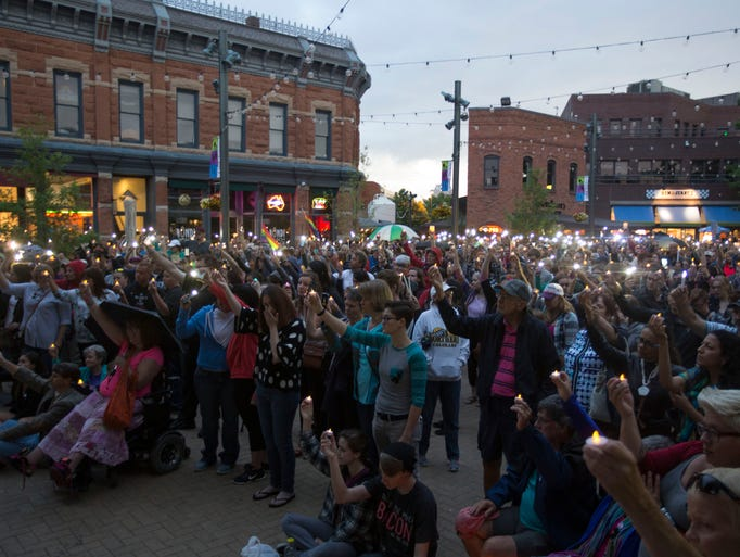 Those who gathered in Old Town Square for a vigil hold