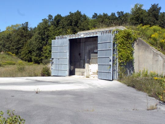 These bunkers at the Seneca Army Depot, once used to store nuclear weapons, were later marketed as secure storage or testing facilities. Photo from 2004.