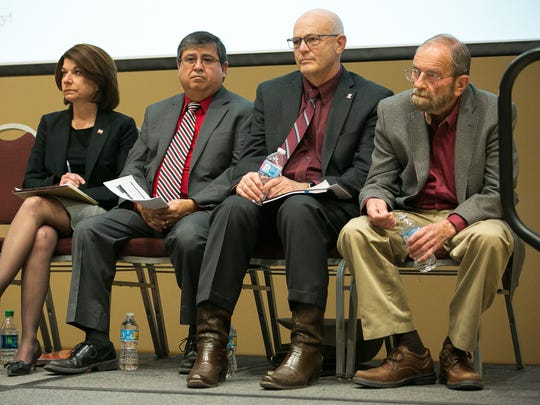 Angela Throneberry, from left, New Mexico State University senior vice president of administration and finance, Ricardo Rel, senior director of government affairs, Dan Howard, NMSU provost, and Jim Peach, NMSU economist, gather on Wednesday March 9, 2016, to present at town hall meeting on the university budget.