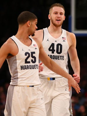 Luke Fischer (right) reacts after dunking the ball against Seton Hall.