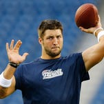 In this file photo from Aug. 29, 2013, Tim Tebow practices with the New England Patriots during the NFL preseason.