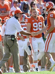 Clemson head coach Dabo Swinney, left, congratulates kicker Alex Spence (41) after his extra point against Boston College during the second quarter in Memorial Stadium at Clemson on Saturday.