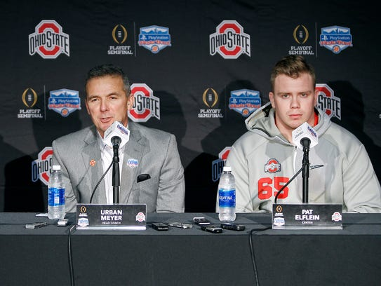 Ohio State head coach Urban Meyer, center, speaks to