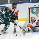 Mercyhurst's Kyle Just is blocked by RIT's Alexander Kuqali as goalie Jordan Ruby stretches to make a save save in the second period.
