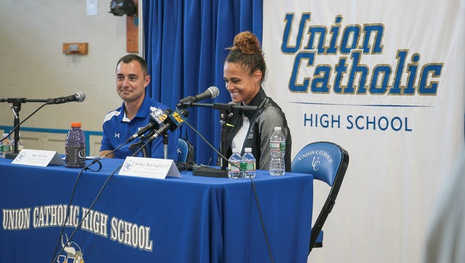 Sydney McLaughlin, right, laughs about a question at a press conference at Union Catholic High School on July 20, 2016. McLaughlin is a 16-year-old track and field athlete heading to the Rio games. At left is Union Catholic track coach Mike McCabe.