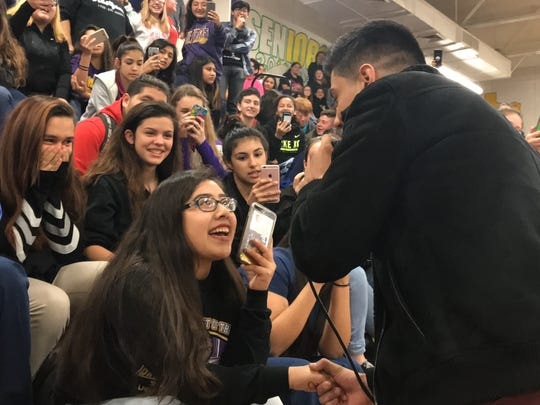 Alondra Mireles, a senior at Aransas Pass High School, sings with Mexican singer Luis Coronel at the Latin Grammy in the Schools Program Feb. 7, 2018.