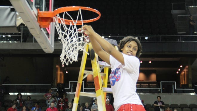 Butler's Bre Torrens cuts the net.  KHSAA Sweet 16 championship game. Girls basketball. March 13, 2016. NKU's BB&T Arena. Butler vs. Franklin County.
