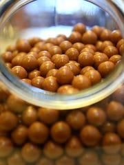 Pumpkin caramel balls at Candy Masterpiece.