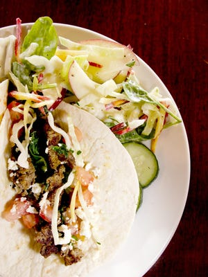 Lamb tacos with a balsamic yogurt sauce at the Salt Fork Kitchen in Solon, Ia.