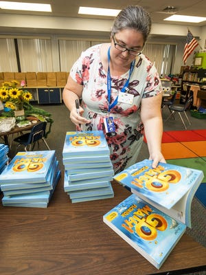 A teacher packs up her classroom for the end of the 2019-20 school year, after schools were closed for weeks due to the COVID-19 pandemic.