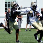 New Orleans Saints wide receiver Brandon Coleman (16) tries to fight off New Orleans Saints defensive back Kenny Phillips (30) during the team's NFL football training camp in White Sulphur Springs, W. Va., Saturday.
