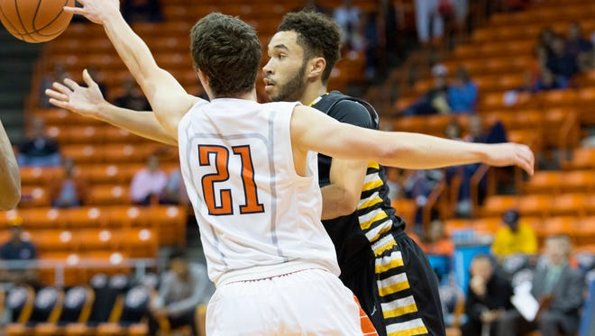 UTEP guard Trey Touchet deflects a pass away while on defense against the Cameron Aggies during an exhibition game Saturday.