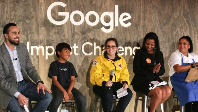 Justin Steele (left), who leads Google.org's Bay Area giving efforts, at the Google Impact Challenge with Bay Area finalists.