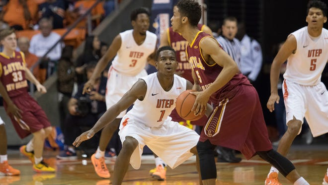 UTEP point guard Dominic Artis, 1, focuses on Jalen Gray, 5, of Loyola of New Orleans on Nov. 14. UTEP won, 96-49.