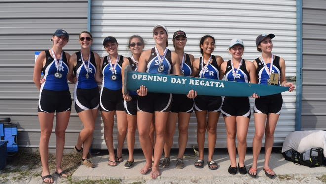 The Sebastian River High School Sharks women's crew varsity eight celebrates winning the perpetual trophy Saturday after the Sharks' hosted the 10th annual Opening Day Regatta on C-54 Canal in Fellsmere.
