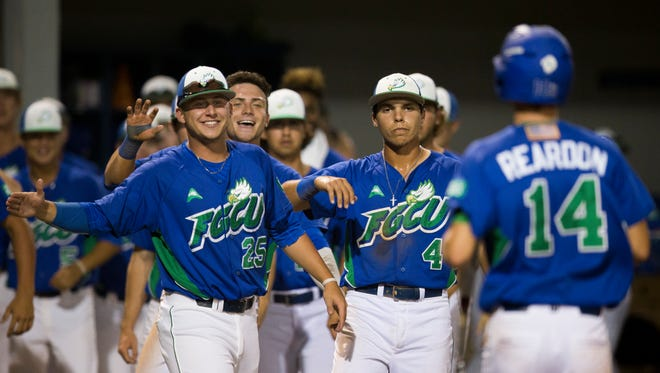 FGCU's Sebastian Gruszecki, from left, Marc Coffers, and Richie Garcia congratulate Matt Reardon after he crosses home plate in the bottom of the seventh inning against the University of Miami at Swanson Stadium Wednesday, March 29, 2017 in Fort Myers. FGCU won 3-0.