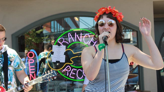 Musicians perform during 2016's Make Music Day in front of Ranch Records.